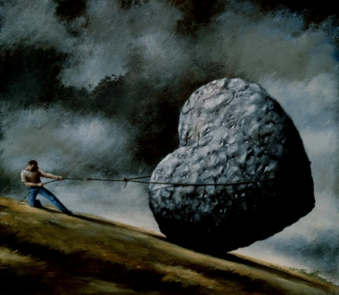 Rope Breaking on Man Holding Stone Heart on Hillside